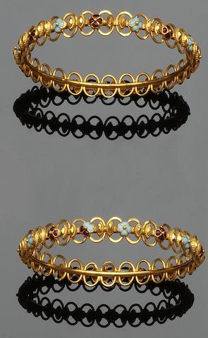 A pair of vari-coloured enamel bangles (2)