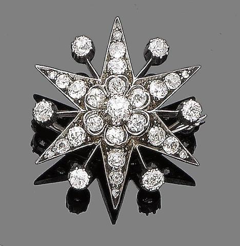 A diamond star brooch,