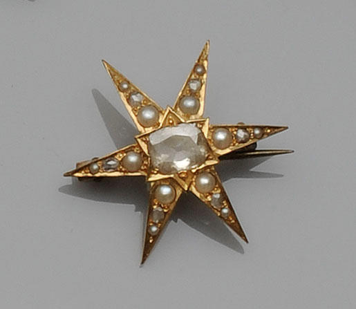 A diamond and half pearl star brooch
