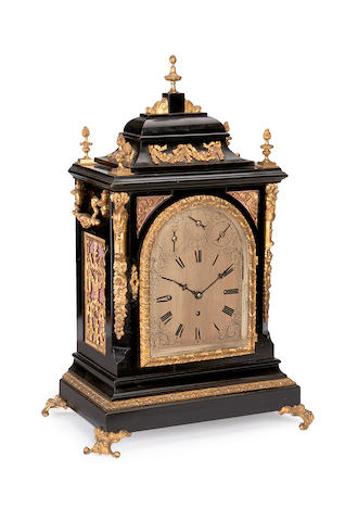 A Victorian ebonised and gilt metal mounted quarter chiming bracket clock