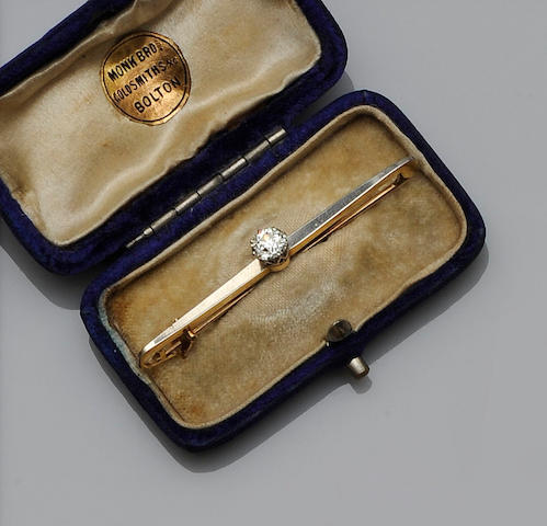 A diamond single stone bar brooch