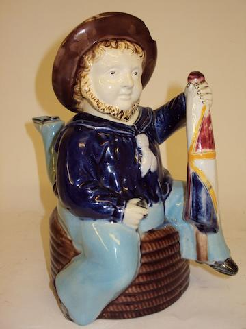 A William Brownfield & Sons majolica Manxman teapot and cover, circa 1885