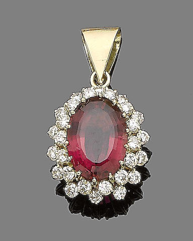 A tourmaline and diamond cluster pendant