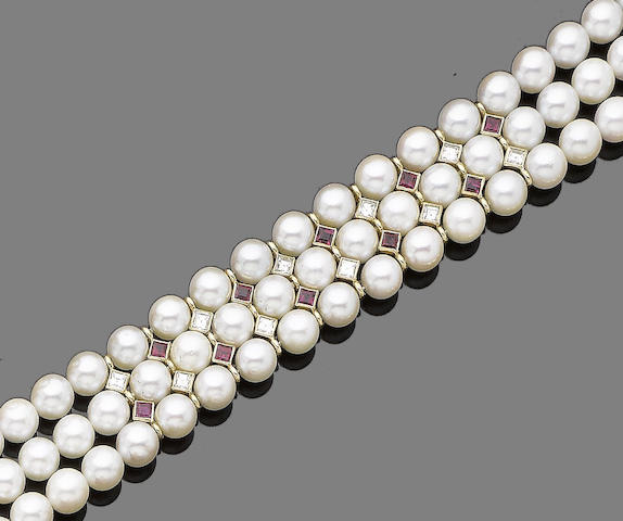 A three-row cultured pearl, ruby and diamond bracelet