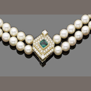 A two strand cultured pearl necklace with an emerald and diamond clasp