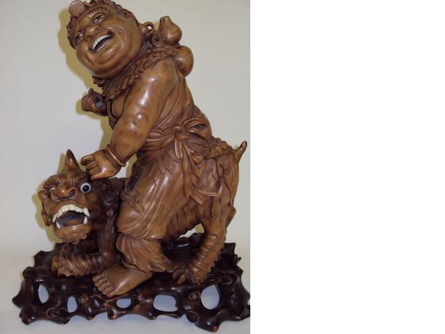 An Asian rootwood figure group on a hardwood stand