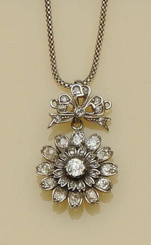 A diamond set flowerhead pendant and chain