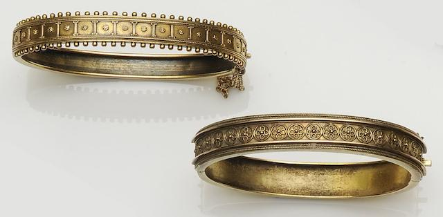 Two Victorian gold Archaeological Revival bangles (2)