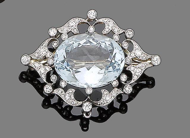 An aquamarine and diamond brooch/pendant,