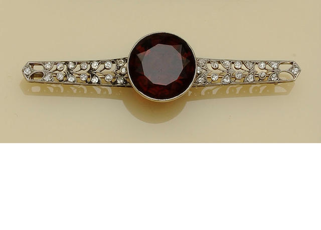 A citrine and diamond bar brooch