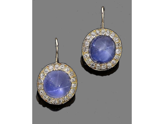 A pair of star sapphire and diamond earrings
