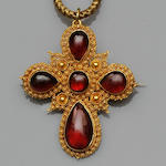 A garnet cross pendant