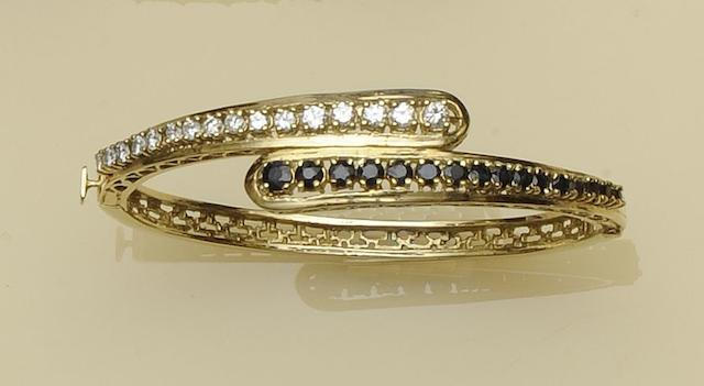 A sapphire and diamond set hinged bangle