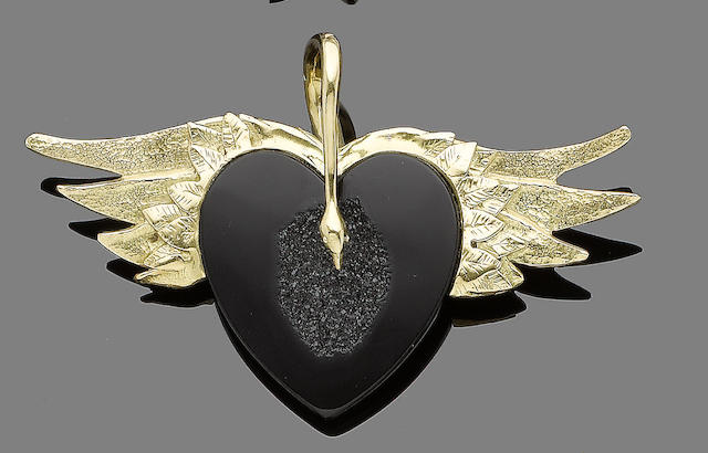 A gold and onyx pendant, by Charmian Harris
