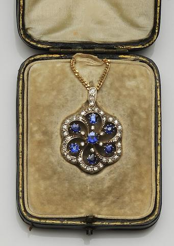 A sapphire and diamond cluster pendant