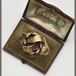 A Victorian gold and enamel brooch