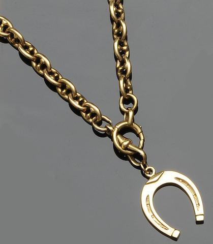 An anchor-link chain with horseshoe pendant