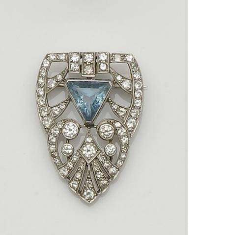 An aquamarine and diamond half clip brooch
