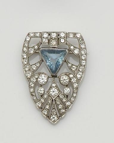 An aquamarine and diamond half clip brooch