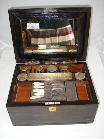 A Victorian coromandel ladies dressing case Maker's mark T.W, London 1880