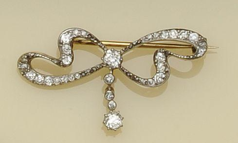 An early 20th century diamond set bow brooch (3)