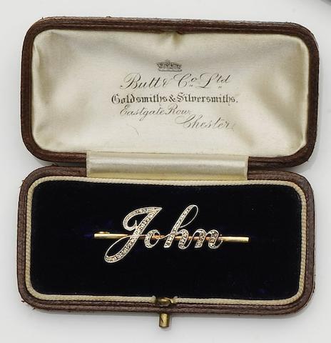 A diamond set name brooch
