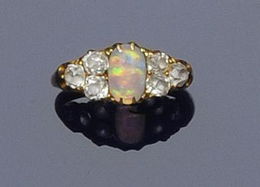 An opal and diamond dress ring and a pair of platinum and diamond earstuds (2)