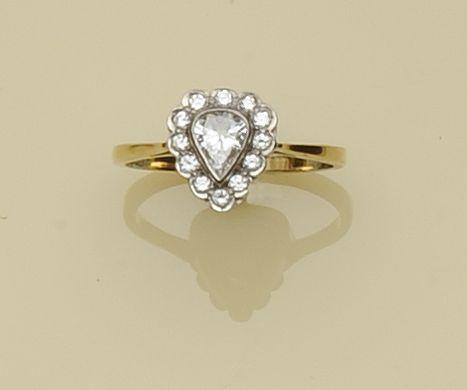 A diamond pear-shaped cluster ring