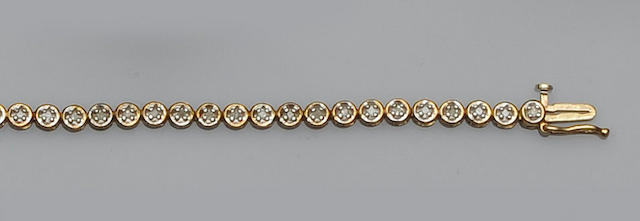 A diamond set line bracelet and a diamond set pendant (2)