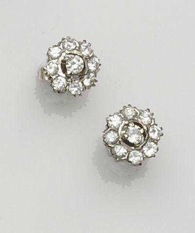 A diamond cluster ring and a pair of white stone earstuds (2)