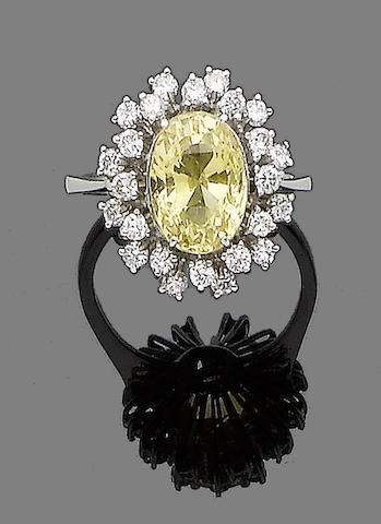 A yellow sapphire and diamond cluster ring