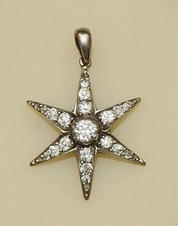 A diamond star pendant