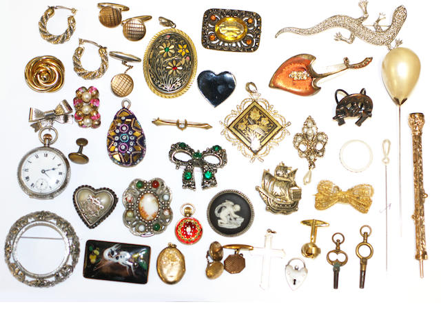 A collection of jewellery and costume jewellery in a brown leather case,