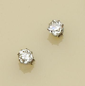 A pair of old-cut diamond single stone earstuds