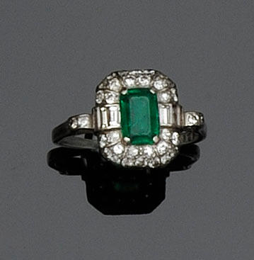 A diamond and emerald cluster ring