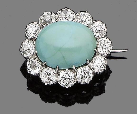 A turquoise and diamond brooch,