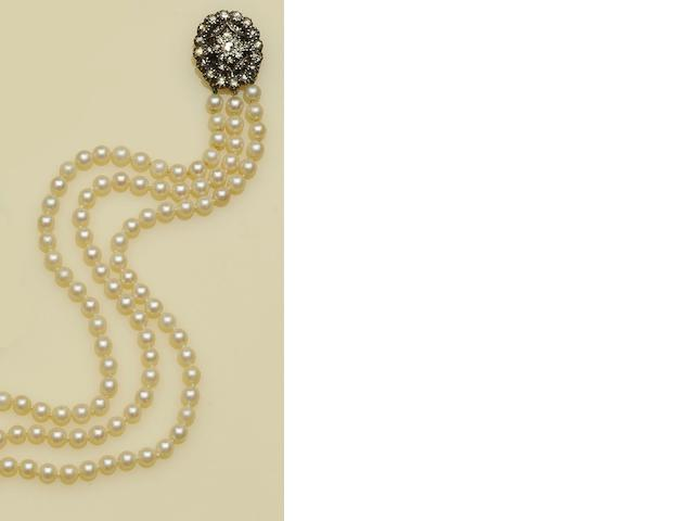 A three row uniform cultured pearl necklace