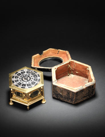 A mid 18th century gilt brass hexagonal table clock with repeat and alarm, together with the original fitted leather case Antony Möltzer, Wien, number 485