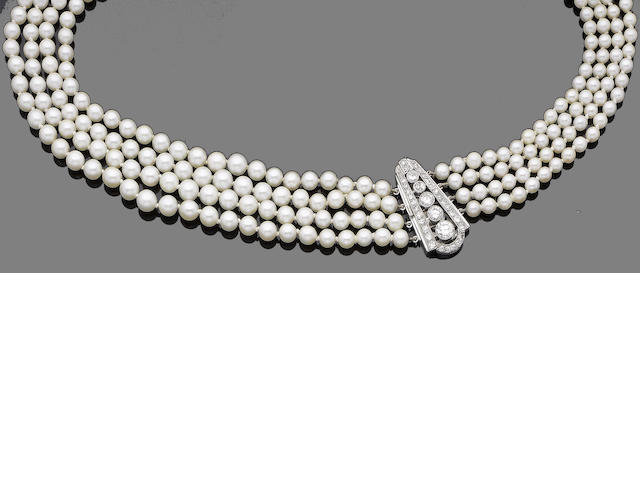 A four-strand cultured pearl and diamond necklace