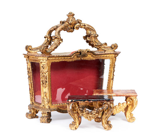 An 18th century Italian giltwood reliquary together with a pair of plinths