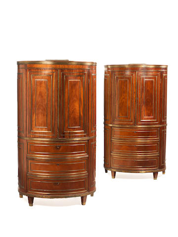 A pair of Russian brass-mounted mahogany demi-lune cabinets