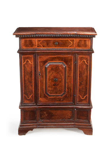 A small Italian early 18th century and later walnut and fruitwood inlaid cabinet