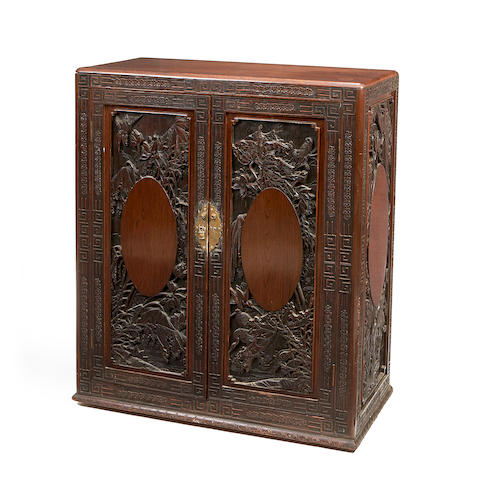 A Japanese export late 19th/early 20th Century hardwood cabinet,
