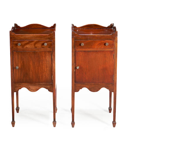 A pair of George III style mahogany bedside traytop commodes