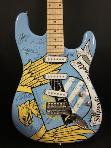 Manchester City Premiership Champions hand signed electric guitar