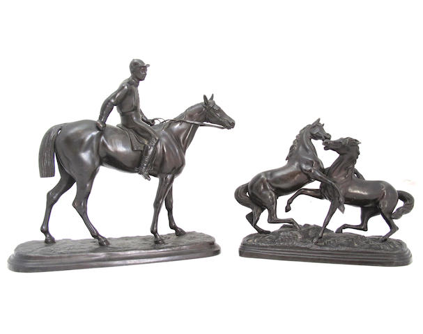 A bronzed metal model of a racehorse with jockey up