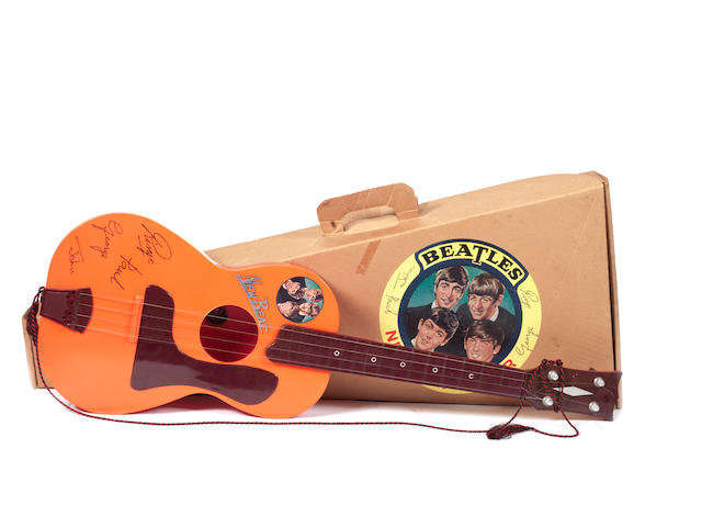 A Beatles 'New Beat' toy guitar, UK, 1960s,