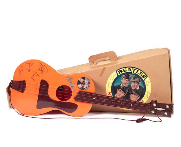A Beatles 'New Beat' toy guitar, UK, 1960s,