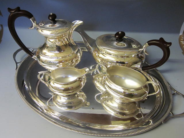 A four piece silver tea service by J B Chatterley and Sons Ltd, Sheffield 1977  (5)