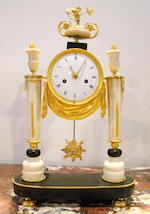 A French late 18th century Louis XVI eight day gilt bronze mounted white marble portico clock